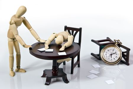 Mannequin slumped over paperwork on his desk and another standing beside.