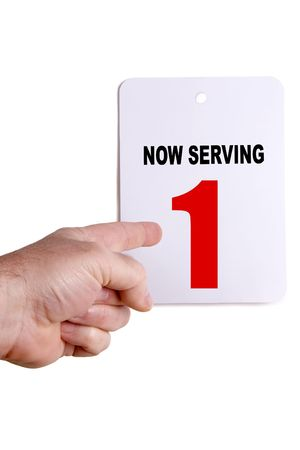 Now serving sign with a hand pointing to the number one.  You're next in line!  Isolated on white. Stock Photo - 2691306