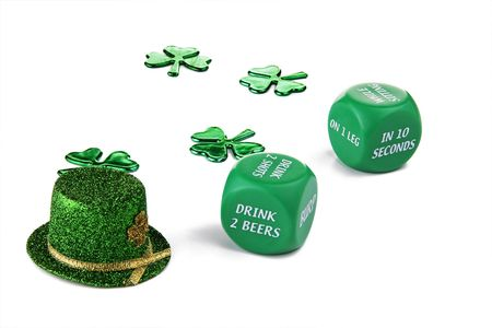 St Patricks Day drinking game.  Roll the green dice and take a drink!  Included is a green leprechaun hat and shamrocks in the background. photo