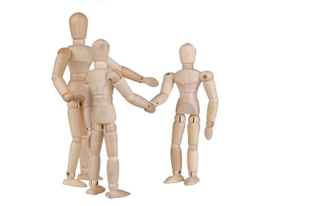 Wooden people meeting; greeting; and introducing.  Isolated on white.  Conceptual for friendship, partnership; business networking, etc.