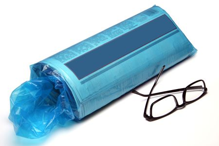 The daily newspaper rolled up and still in the blue plastic bag fresh from the driveway.