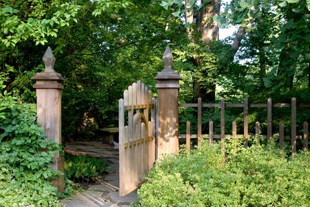 entrance gate: An open garden gate offers an invitation to enter into a shady and secluded area.