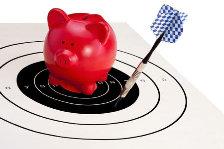 failing: Red piggy bank sits on the bulls-eye of a target and a single blue finned dart falling just short.  Financial concept for failing to save, bank closures, missed oppurtunity, etc.