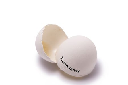 eggshell: Empty eggshell on a white background with the words Retirement.  Humorous concept image for retirement, economic downturn, financial loss, etc. Stock Photo