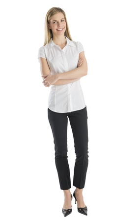 Portrait of happy businesswoman standing arms crossed against white background photo