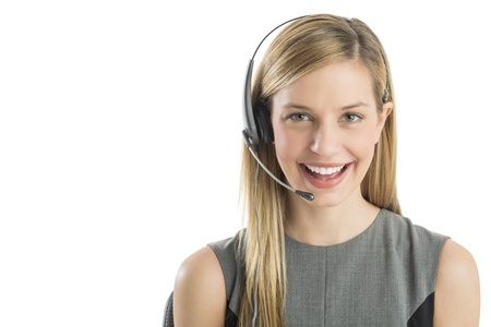 Close-up portrait young female customer service representative wearing headset smiling against white background photo