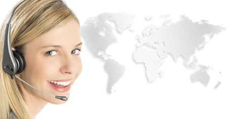 Close-up portrait of female customer service representative wearing headset with world map against white background Standard-Bild