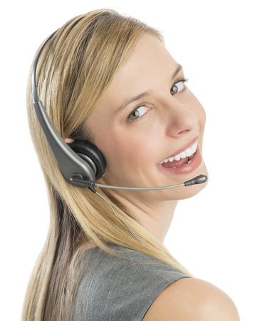 Close-up portrait of beautiful female customer service representative wearing headset against white background photo