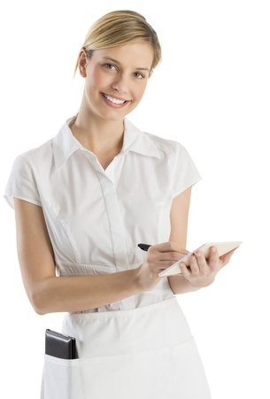 Portrait of beautiful waitress with order pad and pen isolated over white background