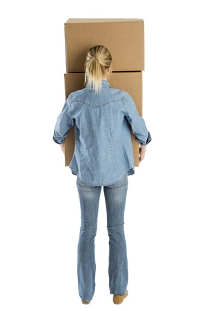 Rear view of young woman carrying stacked cardboard boxes isolated over white background