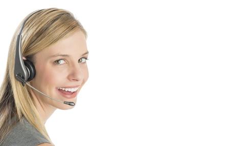 Close-up portrait of happy female customer service representative wearing headset isolated over white background Standard-Bild