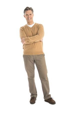 Full length portrait of happy mature man standing arms crossed isolated over white background