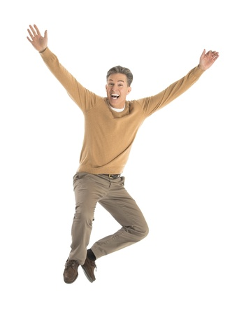 Portrait of cheerful mature man jumping over white background