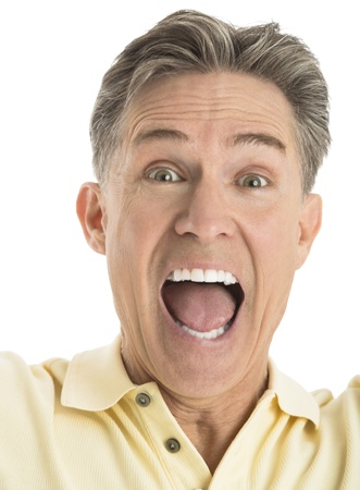 Close-up portrait of excited mature man screaming against white background photo