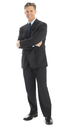 Full length portrait of confident mature businessman standing arms crossed isolated over white background