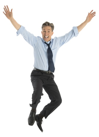 Full length portrait of successful mature businessman jumping in joy against white background photo