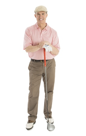 Full length portrait of confident mature man with golf club standing against white background photo