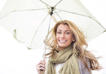 beautiful umbrella: Portrait of young Caucasian woman holding umbrella isolated over white background