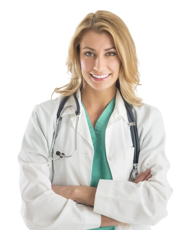 Portrait of confident young female doctor standing arms crossed against white background Standard-Bild