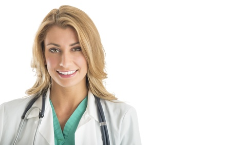 Portrait of beautiful female doctor smiling against white background