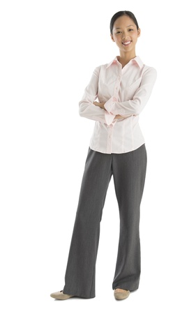 one mid adult woman only: Full length portrait of confident mid adult businesswoman standing arms crossed against white background
