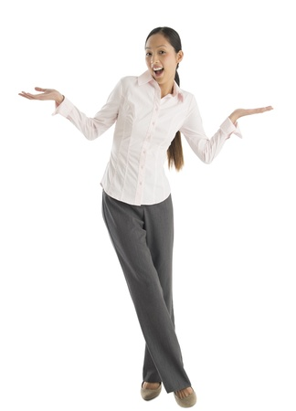 Full length portrait of surprised mid adult businesswoman gesturing while standing against white background