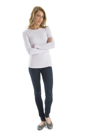 Portrait of confident young woman in casuals standing arms crossed against white background