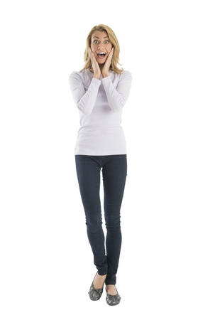 Portrait of amazed young woman screaming while standing against white background photo