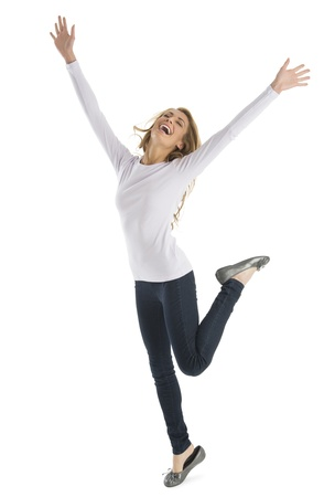 mouth closed: Excited young Caucasian woman with arms raised standing isolated on white background