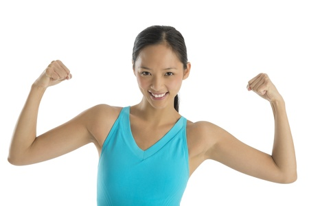 Front view portrait of happy mid adult woman in flexing her muscles isolated on white background photo