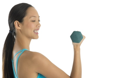 Side view of happy woman lifting dumbbells isolated over white background photo