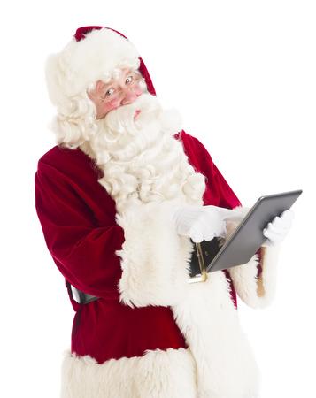 Portrait of Santa Claus using digital tablet against white background Standard-Bild