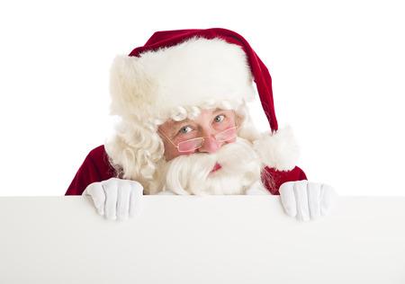 Portrait of Santa Claus peeking through blank billboard against white background Standard-Bild