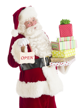 Portrait of Santa Claus with gifts and Open sign standing isolated over white background photo