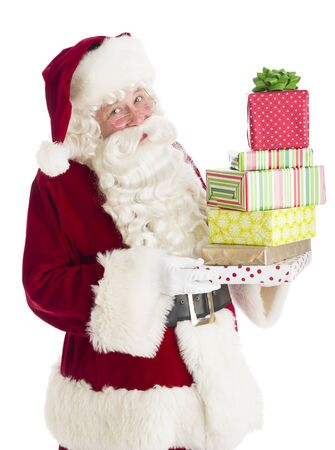 Portrait of Santa Claus holding stack of gift boxes against white background photo