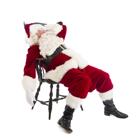 Tired Santa Claus sitting on chair isolated over white background photo