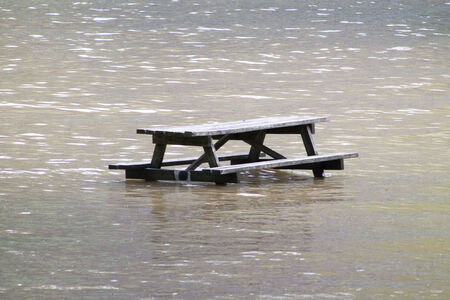 A picnic table succumbs to high water