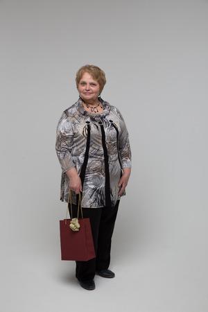 Elegant old lady smiling in a studio Stock Photo