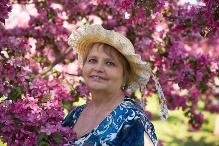 russian hat: Russian woman wearing hat in summer park Stock Photo
