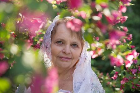 pensioner: Pensioner woman in blossom garden