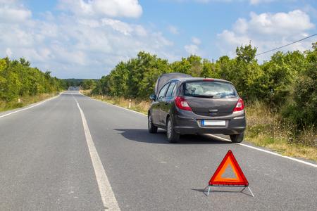 Car malfunction on countryside. Car waiting for help on the road. Car breakdown Stok Fotoğraf