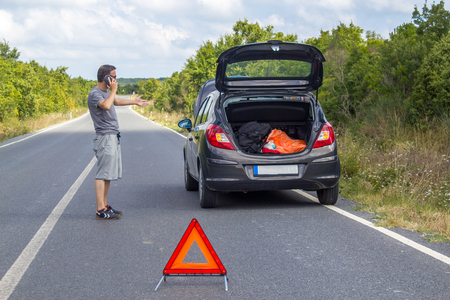 Car malfunction on countryside. Car waiting for help. Car breakdown. Man with car breakdown