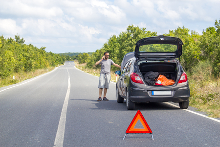 Car malfunction on countryside. Car waiting for help. Car breakdown. Man with car breakdown Stok Fotoğraf - 109776910