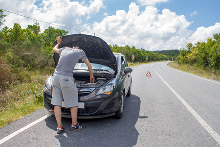 Car malfunction on countryside. Car waiting for help. Car breakdown. Man with car breakdown. Waiting for roadside assistance Stok Fotoğraf
