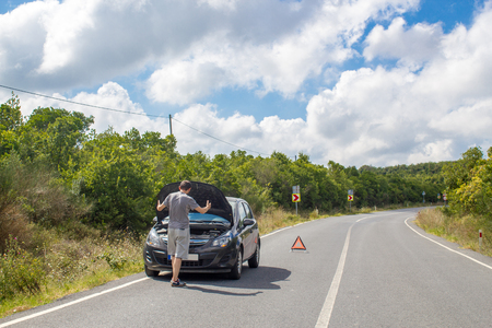 Car malfunction on countryside. Car waiting for help. Car breakdown. Man with car breakdown. Waiting for roadside assistance Stok Fotoğraf - 109776916