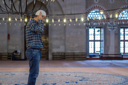 Young caucasian man at the mosque