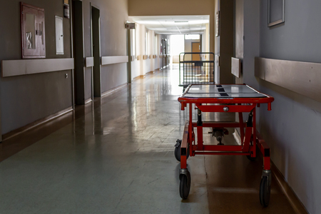 Stretcher and empty hospital corridor