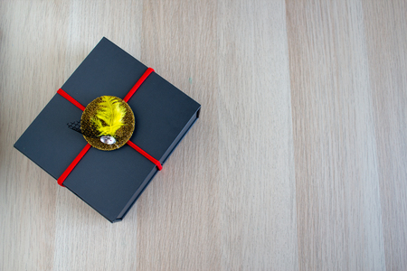 Gray gift box on wooden background