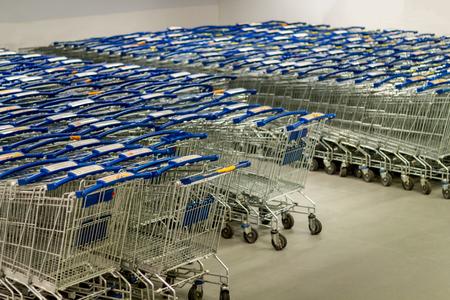 Supermarket shopping carts lined up empty Stok Fotoğraf
