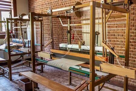 Traditional silk fabric loom. Old method manual fabric weaving machine. No people